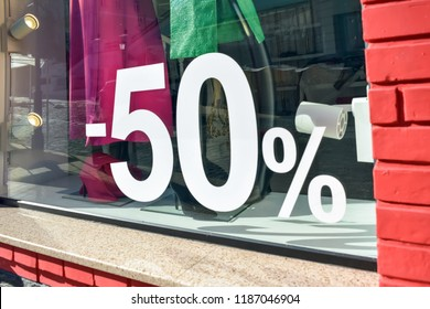 50% off sale discount promotion sale poster, banner, ads in store, shop, drugstore, market window. Sale banner promotion offer percent discount ads in women clothing store boutique.