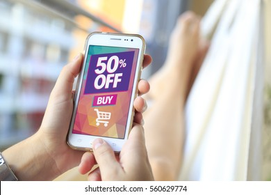 50% OFF Sale. Woman in a hammock with a smartphone with a 50% discount advertising on the screen.  Marketing, ecommerce, discount, email marketing, cell phone publicity.