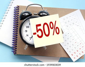 50% Percent Discount Sign, Sale Up to 50%, 50% Sale, Special Offer, Money Smarts Sticker, Save On 50% Icon.  text on the sticker attached to the alarm clock. alarm clock on notepad on blue background