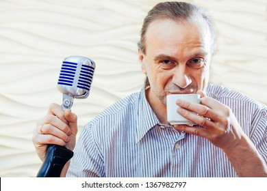 50 plus singer men with old school microphone. Jazz singer with stylish hairstyle singing karaoke. Closeup.