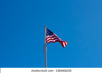 The 50 stars on the USA flag represent the 50 states of the United States of America, and the 13 stripes  the thirteen British colonies that declared independence from the Kingdom of Great Britain.