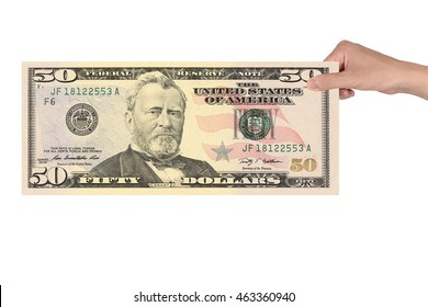 50 US dollar banknotes in hand isolated white background. Ulysses S. Grant first appeared on the fifty-dollar bill in 1913.