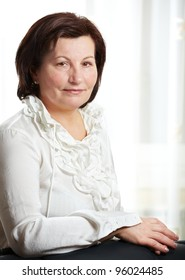50 year old beautiful business woman portrait at the office.