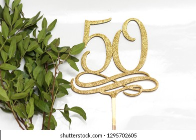 50 years celebration. Wooden topper for cake.