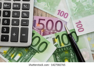 500, 100 euro banknotes and part of a calculator, close-up
