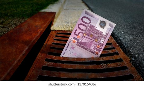 500 Euro banknote down the street storm drain. Concept of senseless waste of money, loss, useless waste