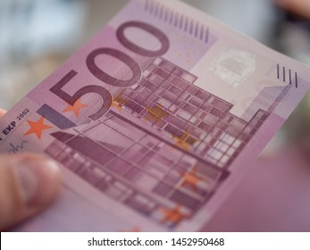 500 Euro in the male hand background
