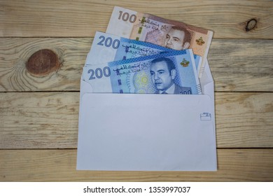 500 Moroccan dirhams. 3 Moroccan banknot in a white envelope, 200 MAD banknote, 100 MAD banknote.