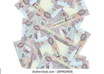 500 UAE dirhams bills flying down isolated on white. Many banknotes falling with white copy space on left and right side