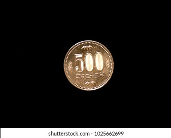 500 yen coin close up on black background