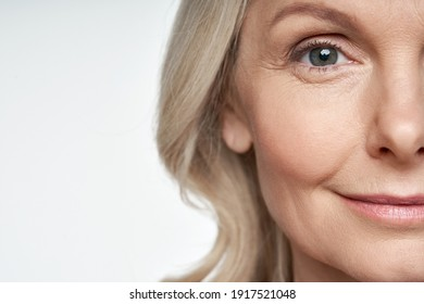 50s middle aged old woman looking at camera isolated on white background advertising dry skin care treatment anti age skincare beauty, plastic surgery, cosmetology procedures. Close up half face view - Shutterstock ID 1917521048