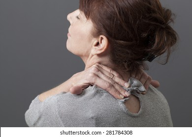 50s woman leaning her head for head and backbone relaxation