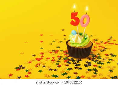 50th Birthday Cupcake With Candle And Sprinkles On Yellow Background Card Mockup Copy Space