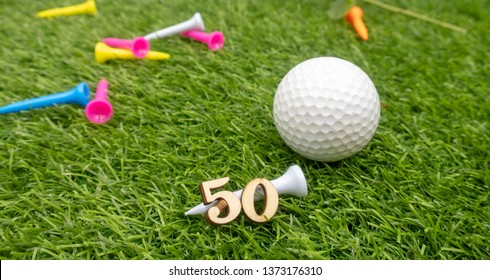 50th birthday of golfer with golf ball and tees are on green grass
