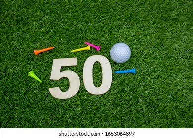 50th birthday to golfer with number 50th golf ball and tee on green grass