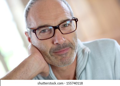 50-year-old attractive man with eyeglasses
