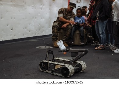 5/28/18- New York,NY - In New York City, the Navy has arrived.  It's fleet week on board the USS Arlington. Child piloting a remote bomb difusion drone.