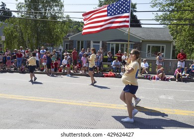 5/30/2016 Camillus Ny-Memorial Day Parade. Marching Band walks down the street in Camillus NY. Guinness book of world records. Around 640 Alumni March in Band.