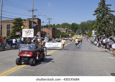 5/30/2016 Camillus Ny-Memorial Day Parade. The focus is on the car in the front. IntentMarching Band walks down the street in Camillus NY. Guinness book of world records.