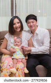 55 day baby feeling happy  with mother and father