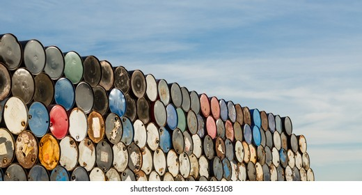 55 gallon drums stacked in a storage facility