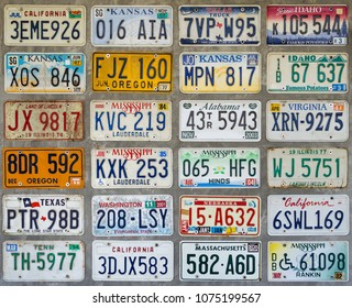 56 ART STUDIO, NAKHONSAWAN, THAILAND - April 13, 2018 : Various Old American License Plates on The Bare Mortar Wall