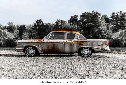 57 Studebaker Rusted / Circa 1957 old rusted vintage Studebaker 2 door car on the side of a road in Holden, Maine. Taken July 2017