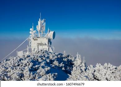 5g antenna on building. winter scene