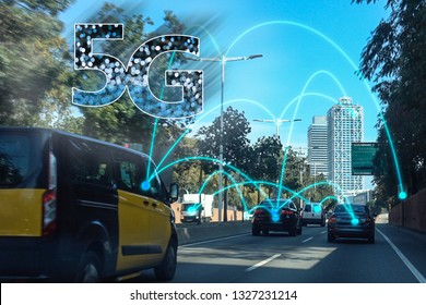 5G auto concept. Abstract image of possible autonomous car in Barcelona City. Suitable for 5G market deployment, smart city and 5G network wireless systems and internet of things