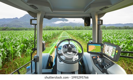 5G autonomous tractor working in corn field, Future technology with smart agriculture farming concept