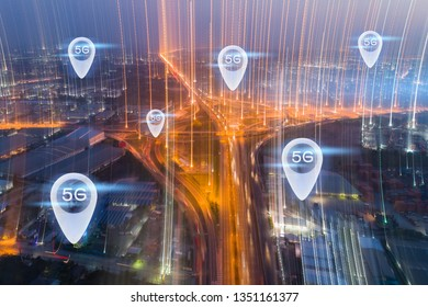 5G internet of think communication concept. Aerial view Night Expressway, toll way, highway, roads in the city.