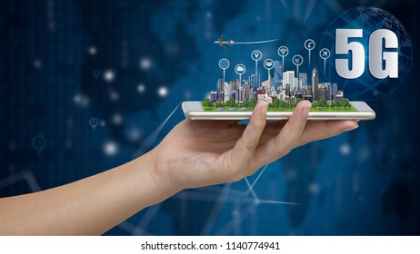 5G network wireless systems and internet of things, Smart city and communication network with smartphone in hand and objects icon connecting together,  Connect global wireless dev