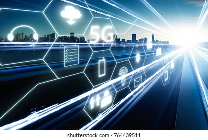 5G network wireless systems and internet of things with  highway overpass motion blur with city skyline background .
