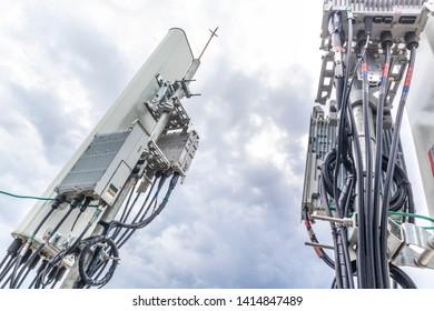 5G smart mobile telephone radio network antenna base station. Transmitter connection system at cellular phone antennas.