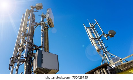 5G smart mobile telephone radio network antenna base station on the telecommunication mast radiating signal