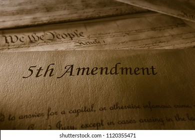 The 5th Amendment with US Constitution in the background