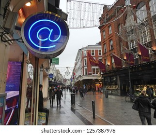 5th December 2018 Dublin. An 'at' sign symbol on Grafton Street, Dublin City Centre, lit up in a blue bulb during the Christmas period in December.