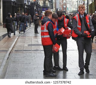 5th December 2018 Dublin. Charity workers collecting donations on Grafton Street for ISPCC Childline during Christmas period.