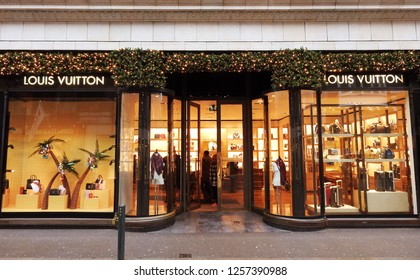 5th December 2018 Dublin. A holly and Christmas lights decorated Louis Vuiton store entrance, part of the Brown Thomas Store on Grafton Street, Dublin during the Christmas period in December.