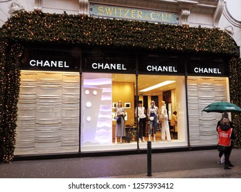 5th December 2018 Dublin. A holly and Christmas lights decorated Chanel store entrance, part of the Brown Thomas Store on Grafton Street, Dublin during the Christmas period in December.