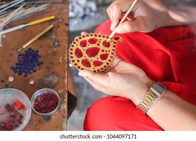 5th March 2018, Nagaon, Assam, India. A female jewellery maker making handmade gold Assamese traditional jewellery in Nagaon, Assam, India.