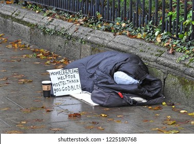 5th November 2018, Dublin. Homeless person with begging message outside St Stephens Green park, Dublin City Centre near Christmas.