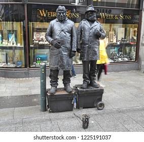 5th November 2018, Dublin. Two frozen statue mime artist buskers on Grafton Street.