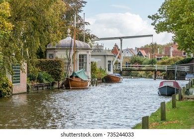 5th October 2017; Edam, The Netherlands; view towards Kwakelbrug bridge with a number of small boats moored by the side of the canal.