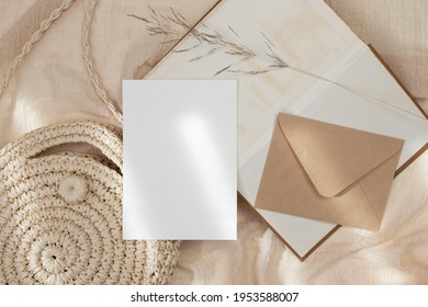 5x7 wedding card mockup with craft envelop and straw bag