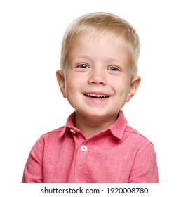 A 5-year-old boy with blond hair in a pink shirt laughs. isolated on a white background. A happy child. Baby teeth.