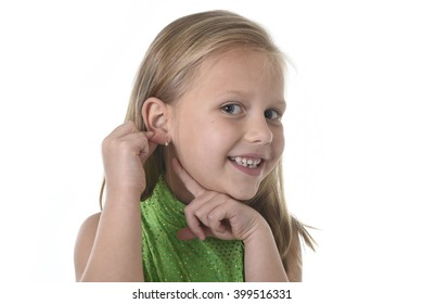6 or 7 years old little girl with blond hair and blue eyes smiling happy posing isolated on white background pointing ear in language lesson for child education and body parts school chart set