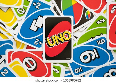 6 April 2019, Wuhan China : Uno game cards scattered all over the frame and one card showing the reverse side with Uno logo close-up
