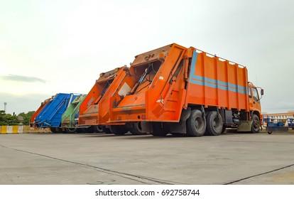 6 garbage trucks parked.