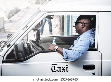 6 Jan 2017 - Nassau, Bahamas. Picture of a taxi driver enjoying his free time drinking beer on the sun.
